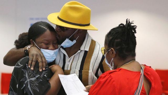 Parents and a student react after checking the GCSE results at Ark Academy, amid the spread of the coronavirus disease (COVID-19), in London, Britain August 20, 2020. REUTERS/Peter Nicholls