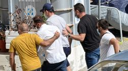 Harry Maguire, in the blue cap, at a police station on Syros. Pic: Athena Pictures