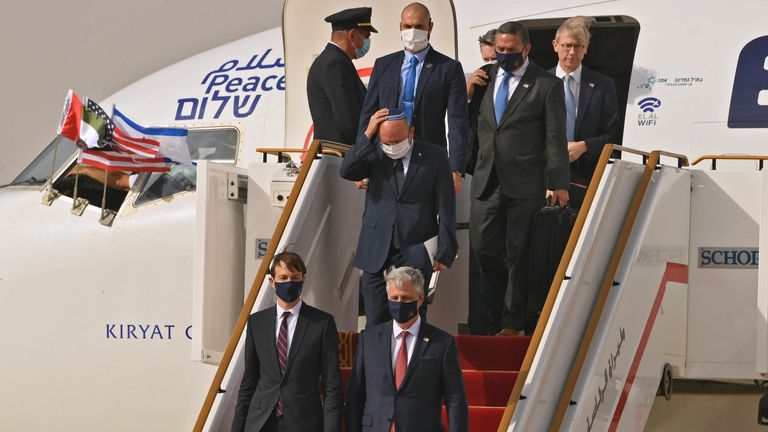 US presidential adviser Jared Kushner (C-L) and US national security adviser Robert O'Brien (C-R) disembark from the flight