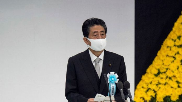 Japanese Prime Minister Shinzo Abe delivers remarks at memorial service in Tokyo