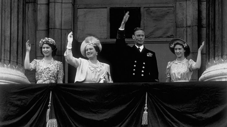 Princess Elizabeth, Queen Elizabeth, King George VI and Princess Margaret waved from the Buckingham Palace balcony as crowds gathered to celebrate