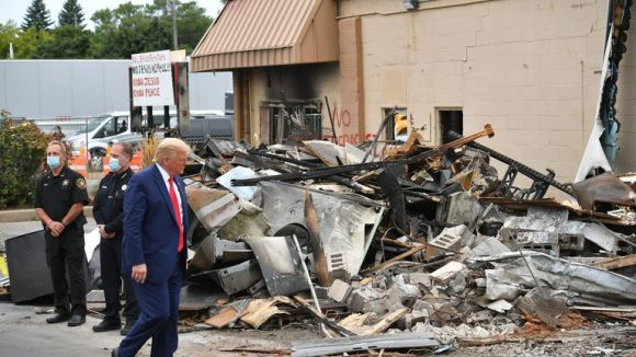 US President Donald Trump tours an area affected by civil unrest in Kenosha, Wisconsin on September 1, 2020. - Trump visited Kenosha, the Wisconsin city at the center of a raging US debate over racism, despite pleas to stay away and claims he is dangerously fanning tensions as a reelection ploy. (Photo by MANDEL NGAN / AFP) (Photo by MANDEL NGAN/AFP via Getty Images)
