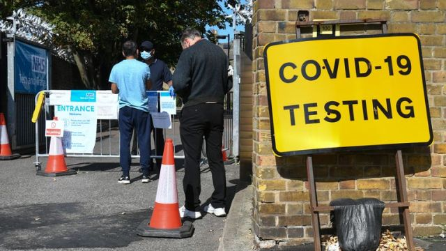 Coronavirus - Fri Sep 18, 2020 People queue up outside a coronavirus testing centre offering walk-in appointments in east London.