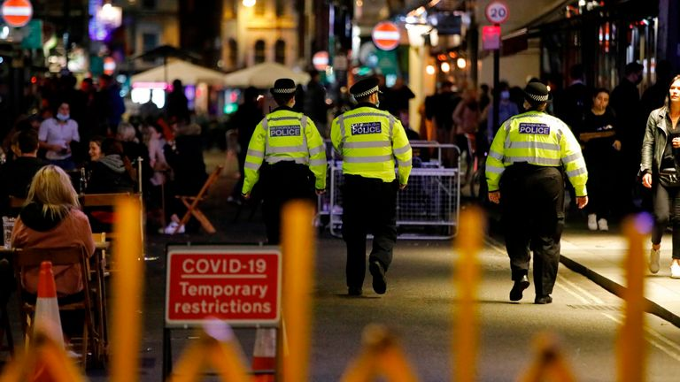 Police patrol in Soho, in central London on September 24, 2020, on the first day of the new earlier closing times for pubs and bars in England and Wales,