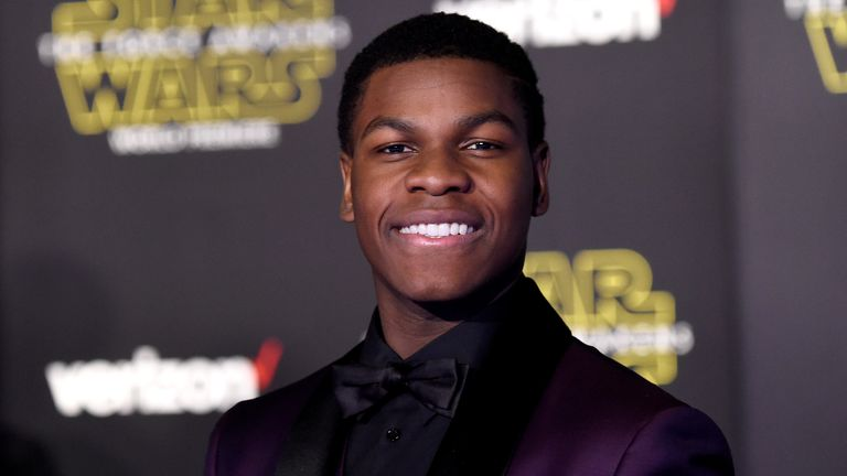 """John Boyega attends the premiere of Walt Disney Pictures and Lucasfilm's """"Star Wars: The Force Awakens"""" on December 14th, 2015 in Hollywood, California."""