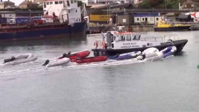 Empty dinghys being pulled by harbour patrol.