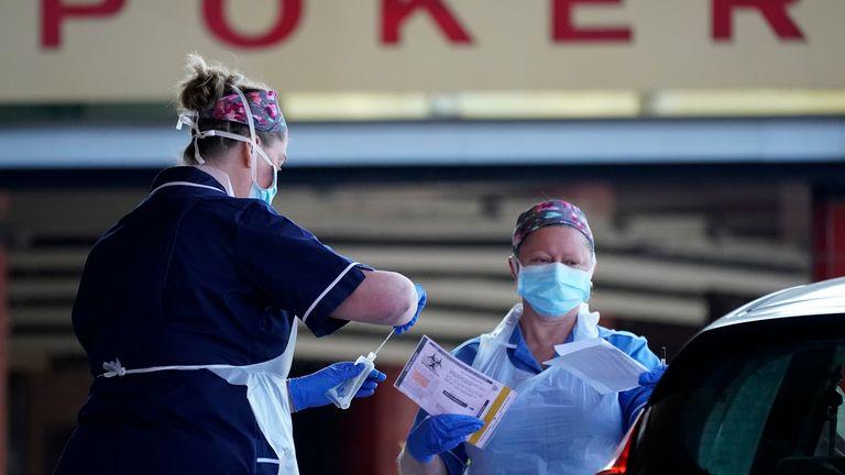 Nurses help NHS workers as they self swab