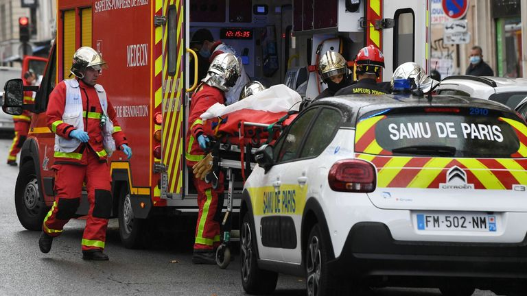 French firefighters load one of the several people injured into a waiting ambulance near the former offices of the French satirical magazine Charlie Hebdo following an alleged attack by a man wielding a knife in the capital Paris on September 25, 2020. - The threats coincide with the trial of 14 suspected accomplices of the perpetrators of the massacres at Charlie Hebdo and a Jewish supermarket that left a total of 17 dead. (Photo by Alain JOCARD / AFP) (Photo by ALAIN JOCARD/AFP via Getty Image