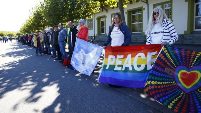 Peace protesters formed a chain as far-right groups marched
