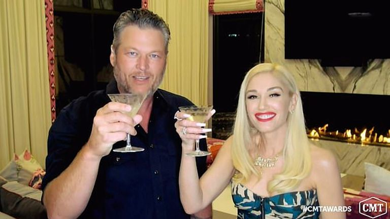Blake Shelton (left) and Gwen Stefani toast their win for collaborative video of the year. Pic: CMT