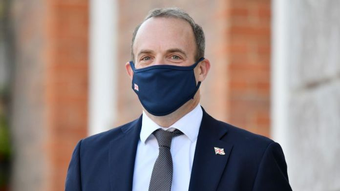 Foreign Secretary Dominic Raab wearing a face mask waits for the French and German foreign ministers to arrive for an E3 Ministers meeting at Chevening House in Sevenoaks, Kent.