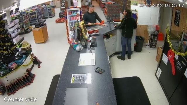 Kempson is seen buying a spade from an out of town hardware store