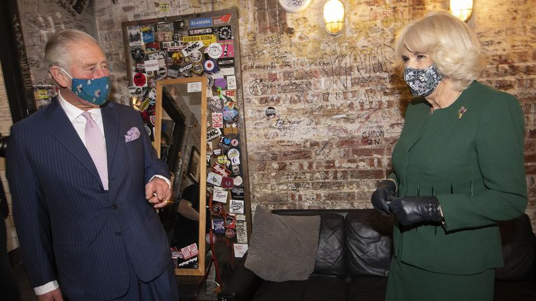 The Prince of Wales and Duchess of Cornwall, Charles and Camilla, during a visit to the 100 Club nightclub in London