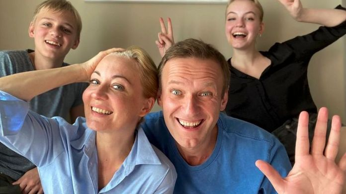 Alexei Navalny and his wife Yulia pose for a selfie with their children in a video released on December 31 on his Instagram account