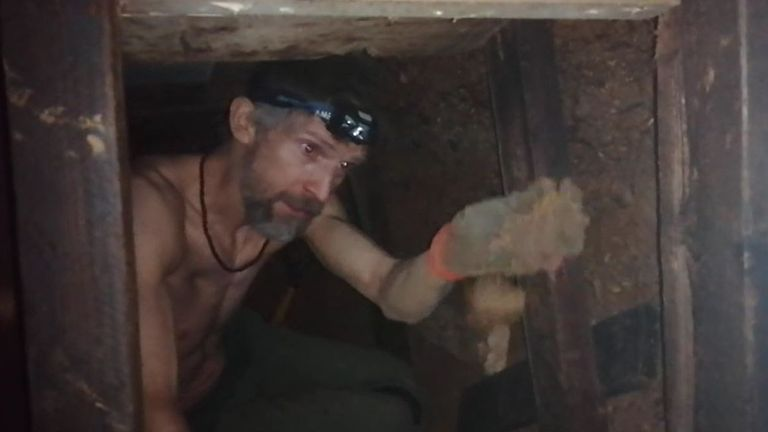 Undated handout video grab issued by HS2 Rebellion of a protester known as 'Larch' in part of a 100ft tunnel network dug in secret under Euston Square Gardens in central London, which they claim is at risk from the HS2 line development. Issue date: Tuesday January 26, 2021.
