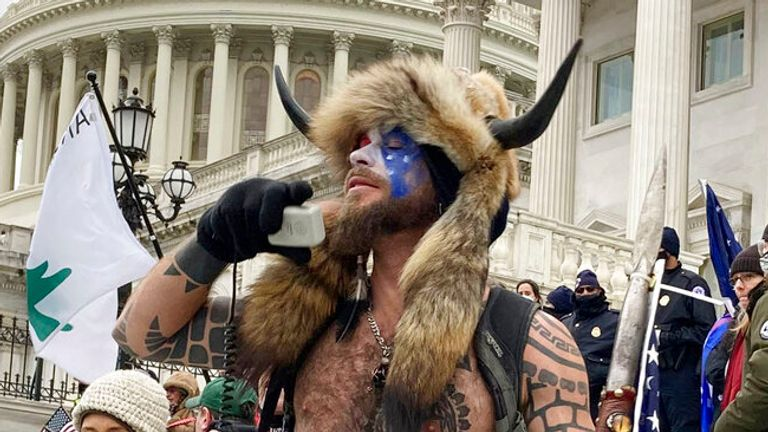 Photo by: zz / STRF / STAR MAX / IPx 2021 1/7/21 Jake Angeli, a QAnon shaman, was seen storming the Capitol building in Washington, DC yesterday. STAR MAX FILE PHOTO: 1 / 6/21 The United States Capitol in Washington, DC was attended by thousands of protesters during a
