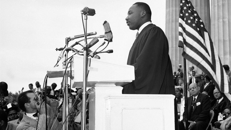 The Rev. Martin Luther King Jr., of Montgomery, Alabama speaks at a mass demonstration before the Lincoln Memorial in Washington as civil rights leaders called on the government to put more teeth in the Supreme Court's desegregation decisions, May 17, 1957. King said both Democrats and Republicans have betrayed the cause of justice on civil rights questions. (AP Photo/Charles Gorry)