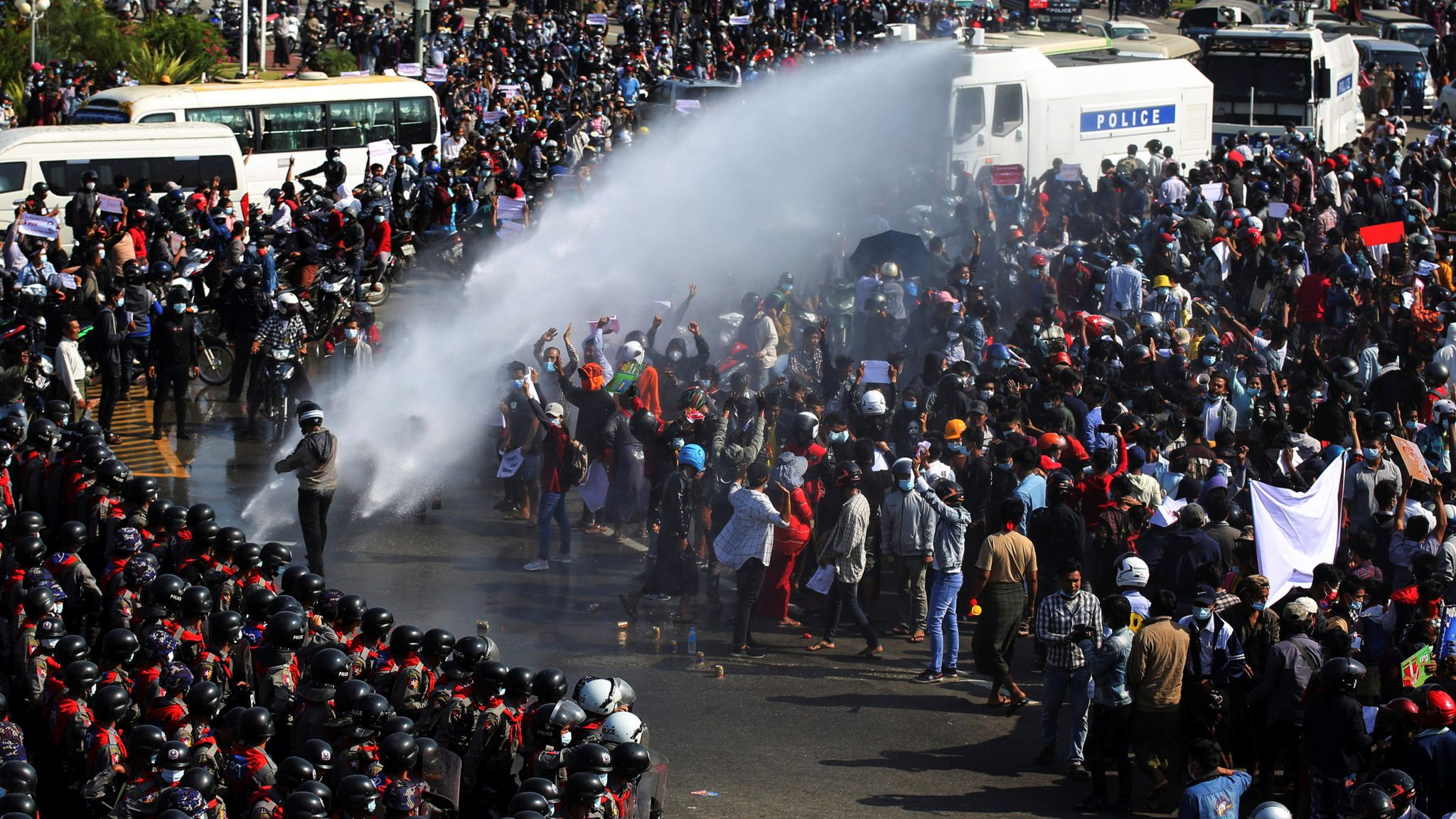 Myanmar: Police fire water cannon as protests grow over military coup |  World News | Sky News