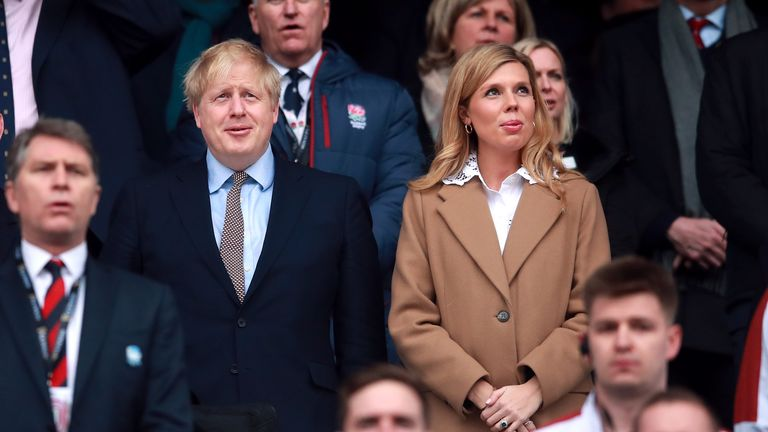 Prime Minister Boris Johnson and partner Carrie Symonds in the stands during the Guinness Six Nations match at Twickenham Stadium, London.