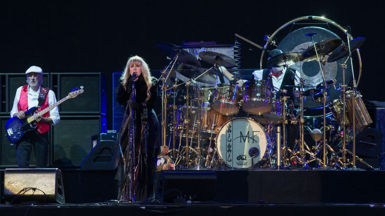 John McVie, from left, and Stevie Nicks and Lindsey Buckingham of Fleetwood Mac performsat the Isle of Wight Festival in 2015. Pic: AP