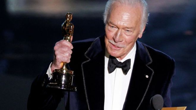 """Plummer, accepts the Oscar for best supporting actor for his role in """"Beginners"""" at the 84th Academy Awards in Hollywood"""