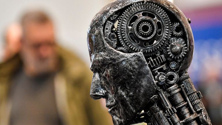 FILE - In this file photo from November 29, 2019, a metal head made of engine parts symbolizes artificial intelligence (AI) at the Essen Motor Show for tuning and motorsport in Essen. The Trump administration is proposing new rules defining how the U.S. government will govern the use of artificial intelligence in medicine, transportation, and other industries. The White House unveiled the proposals on Tuesday, Jan. 7, saying they were intended to promote safe uses of AI in the private sector