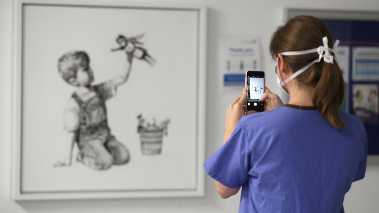 Banksy's hospital painting 'sells for record £16.8m' - raising money for  health charities | Ents & Arts News | Sky News
