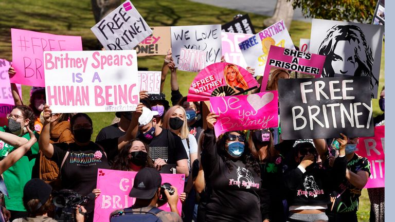 Fans hold 'Free Britney' placards outside the court hearing in Los Angeles. Pic: AP
