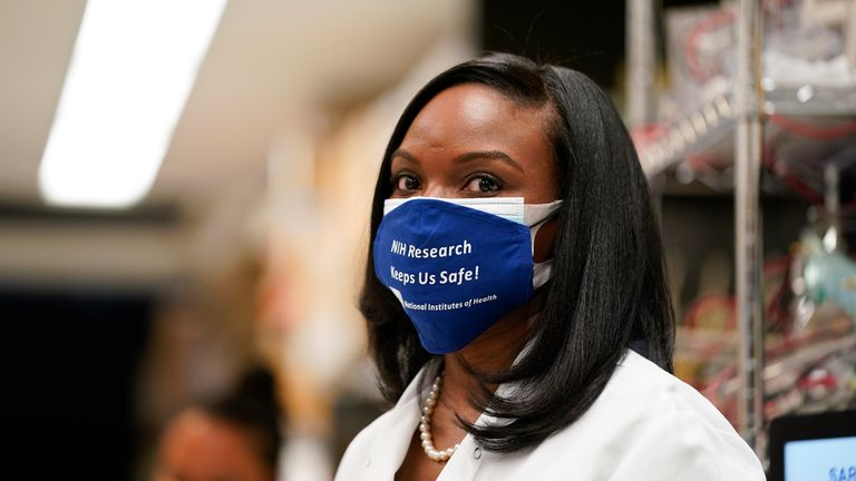 Kizzmekia Corbett, an immunologist at the National Institutes of Health (NIH) Vaccine Research Center, watches as President Joe Biden visits the NIH Viral Pathogenesis Laboratory in Bethesda, Md. (AP Photo) / Evan Vucci on Thursday, February 11, 2021 )