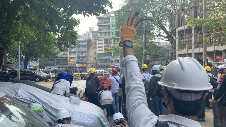 A pro-democracy activist displays the three-finger salute, known to be a symbol of resistance