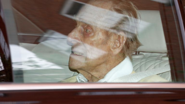 CREDIT AP Britain's Prince Philip leaves the King Edward VII hospital in the back of a car  in London, Tuesday, March 16, 2021. The 99-year-old husband of Queen Elizabeth II has been hospitalized after a heart procedure. (AP Photo/Alastair Grant)
