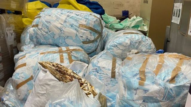Hospital waste such as gowns, curtains and single-use masks waiting to be recycled