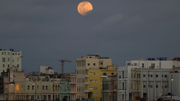 The full moon, also known as the supermoon, rises over Havana, Cuba on April 26, 2021. REUTERS / Alexandre Meneghini