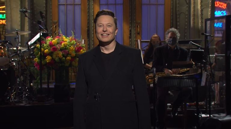 Elon Musk smiles as the audience laughs at his jokes as he hosts Saturday Night Live. Image: NBC / YouTube