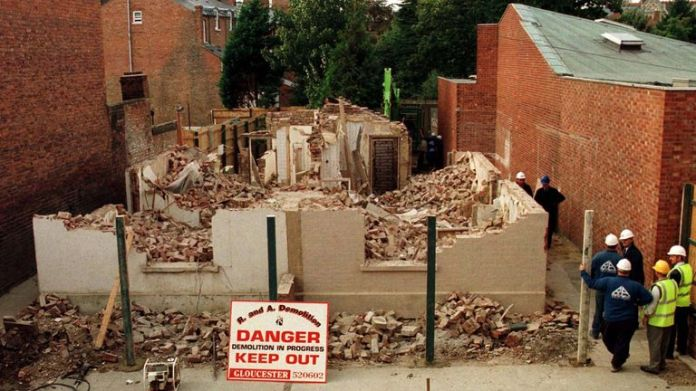 Workers watch 25 Cromwell Street Gloucester, the former home of serial killers Fred and Rosemary West, demolished on October 11.