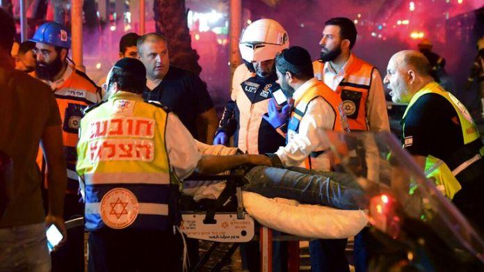 Israeli medics treat a man injured in the airstrikes.  Pic: AP