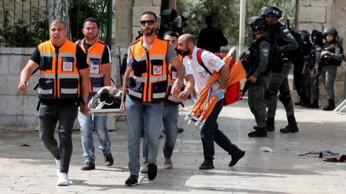 A wounded Palestinian is evacuated