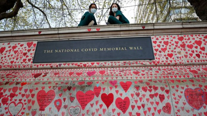 Nurses from nearby St Thomas Hospital rest on the National Covid Memorial Wall in London on Tuesday, April 27, 2021. British Prime Minister Boris Johnson denied a press article quoting him as saying he would rather see. . bodies multiply by the thousands ... that impose a third national lockdown on the country.  The Daily Mail claimed Johnson made the comment in the fall of 2020, when his government imposed a second lockdown to tackle an increase in coronavirus cases.  (AP Photo / Frank Augstein)