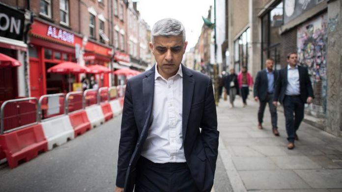 Labour's Mayor of London Sadiq Khan walks along Brick Lane in East London