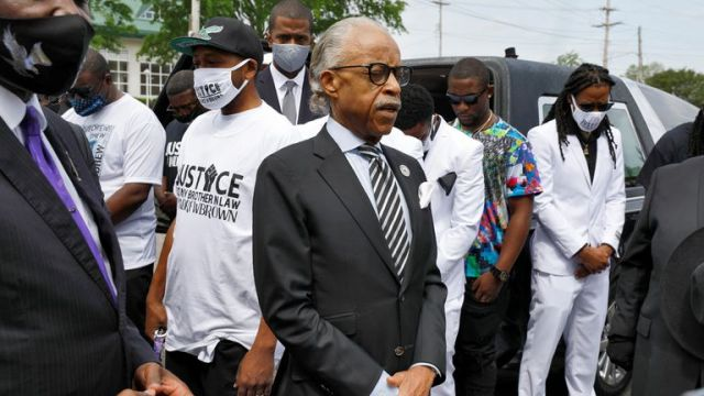 Reverend Al Sharpton leads the family in prayer shortly before the start of a funeral procession for Andrew Brown Jr. in Elizabeth City, North Carolina, U.S., May 3, 2021