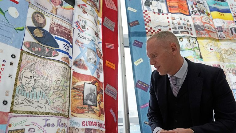 """Robert Rinder, ITVs 'Judge Rinder, looks at a photo of his grandfather, Moishe Malenicky, one of the young Holocaust survivors known as 'The Boys' at Newcastle's City Library for the exhibition opening of """"A Picture, A Life, A Future"""" as part of Holocaust Memorial Day 2018. PRESS ASSOCIOCIATION Photo. Picture date: Sunday January 28, 2018. The free exhibition runs until 8th February. Photo credit should read: Owen Humphreys/PA Wire"""