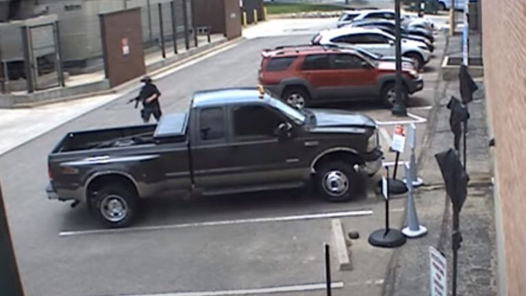 The gunman returned to his pick-up to get another weapon. Pic: Arvada Police Department