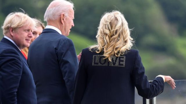"""Jill Biden wearing a jacket with the word """"Love"""" stands next to U.S. President Joe Biden, Britain's Prime Minister Boris Johnson and his wife Carrie Johnson"""