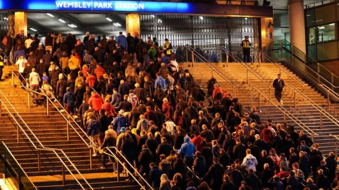 Fans crowd into Wembley Park station after the match
