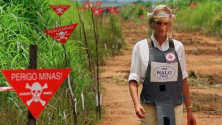 Princess Diana is pictured with a Halo Trust protective vest in a minefield in Angola in 1997