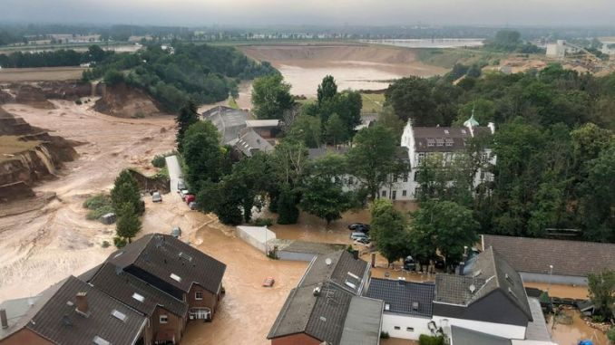 Rescuers were rushing Friday to help people trapped in their homes in the town of Erftstadt, southwest of Cologne. Pic: AP
