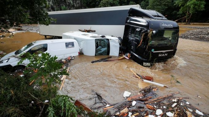 Partially submerged vehicles are pictured on a flood-affected area, following heavy rainfalls in Schuld, Germany, July 15, 2021. REUTERS/Wolfgang Rattay