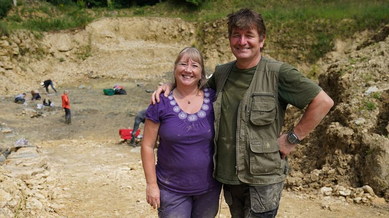 Neville (right) and Sally Hollingworth pose for a photo during an excavation at a quarry in the northern Cotswolds where preserved echinoderms, sea lilies and echinoids from the Mid Jurassic were found after the site was discovered by them. Picture date: Thursday July 1, 2021.