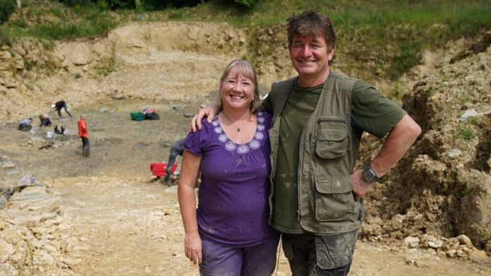 Neville (right) and Sally Hollingworth pose for a photograph during a dig in a quarry in the north Cotswolds, where preserved echinoderms, sea lilies and echinoids, dating back to middle Jurassic period, have been found after the site was discovered by them. Picture date: Thursday July 1, 2021.