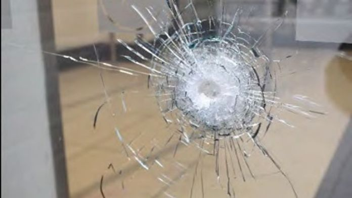 One of the bullets hit a nearby supermarket. Pic: Gardham/Met Police